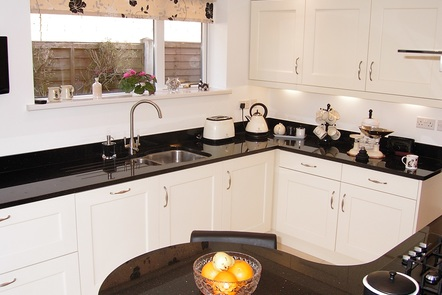 Ivory Belfell with Curved Black Star Granite